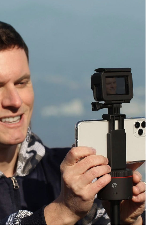 man mounting smartphone on action mount