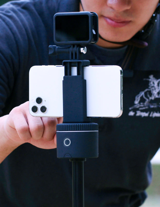 man setting smartphone mounted on action mount