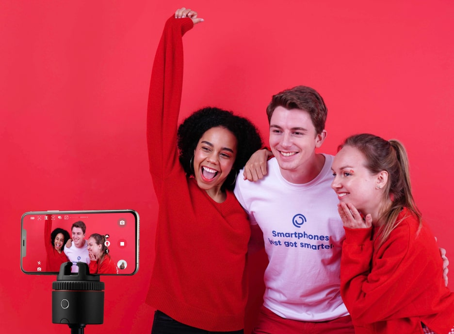 two women and one man traking picture using pivo pod red
