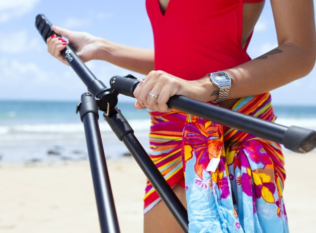 woman in swimsuit holding a pivo tripod