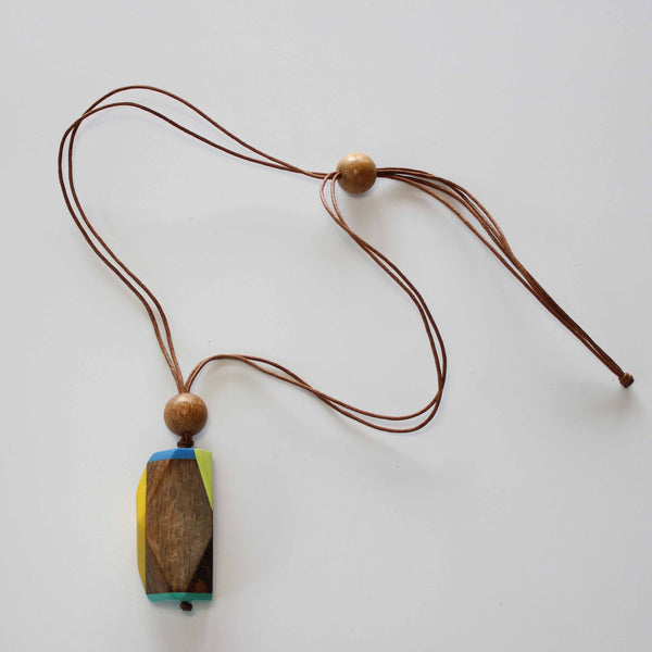 NATURAL WOOD FACETED PENDANT WITH RESIN