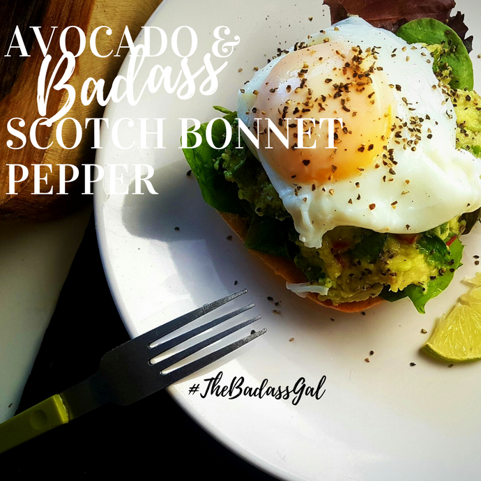 Avocado with scotch bonnet pepper and poached eggs on toast
