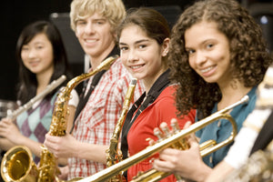 Students playing saxophone
