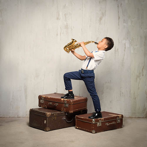 Young student playing soprano saxophone