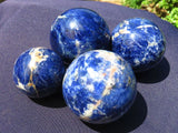 4 Polished sodalite balls - Top Rocks