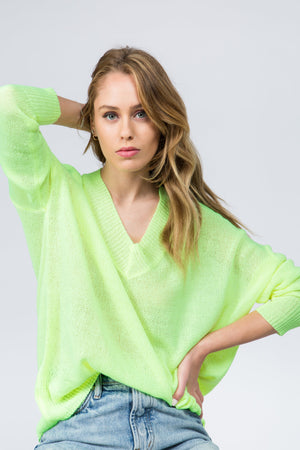 Lightweight boxy neon yellow sweater with v neck and long sleeves