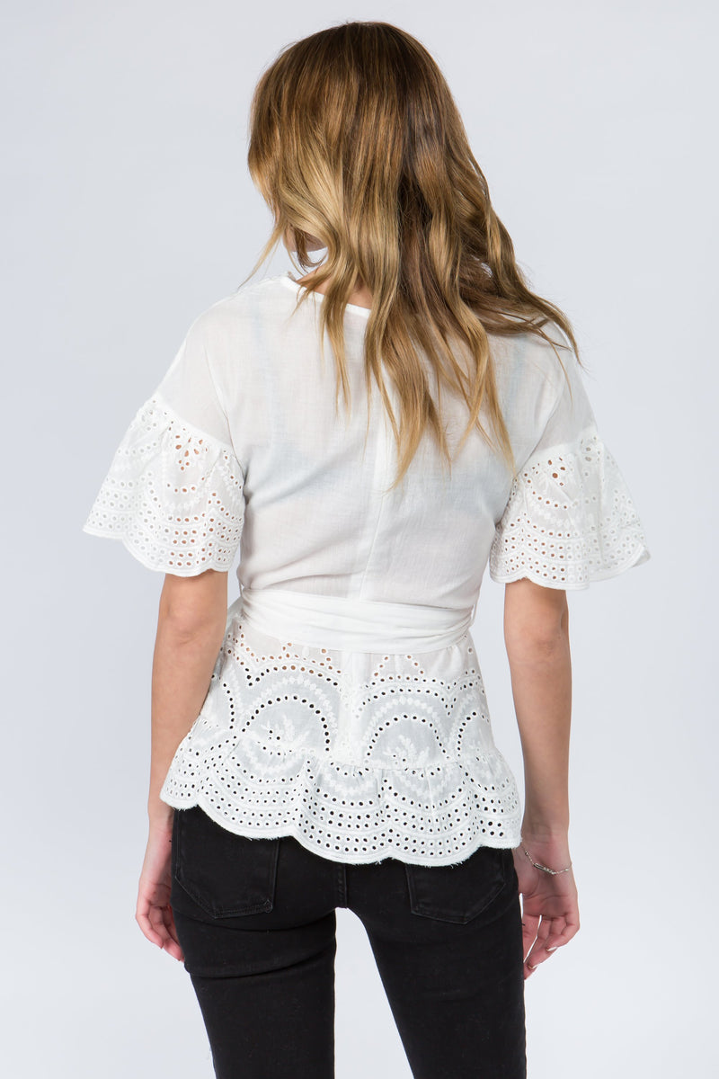 Lace blouse with a faux wrap front and tie in white