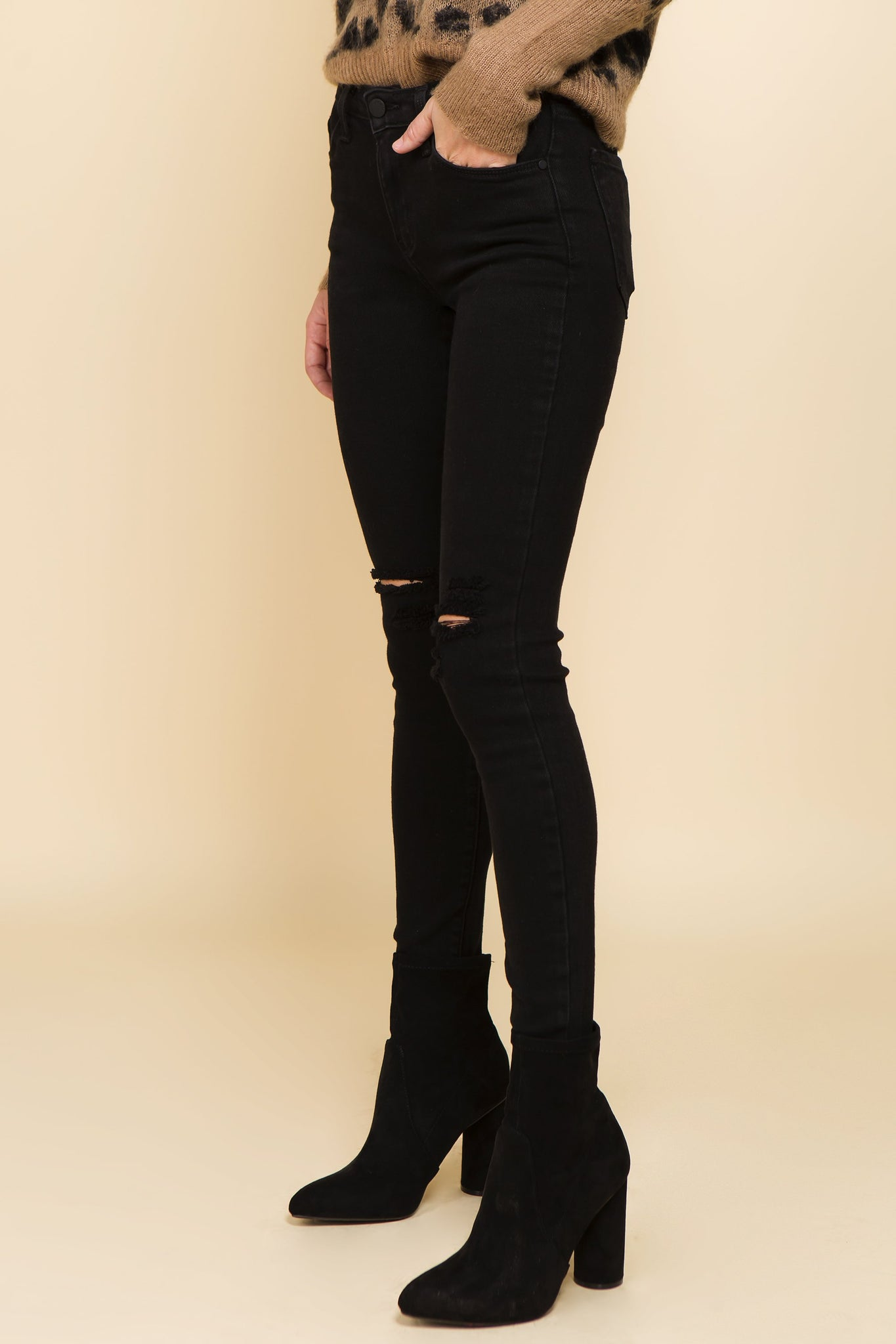Highwaisted distressed black denim with unfinished hemline