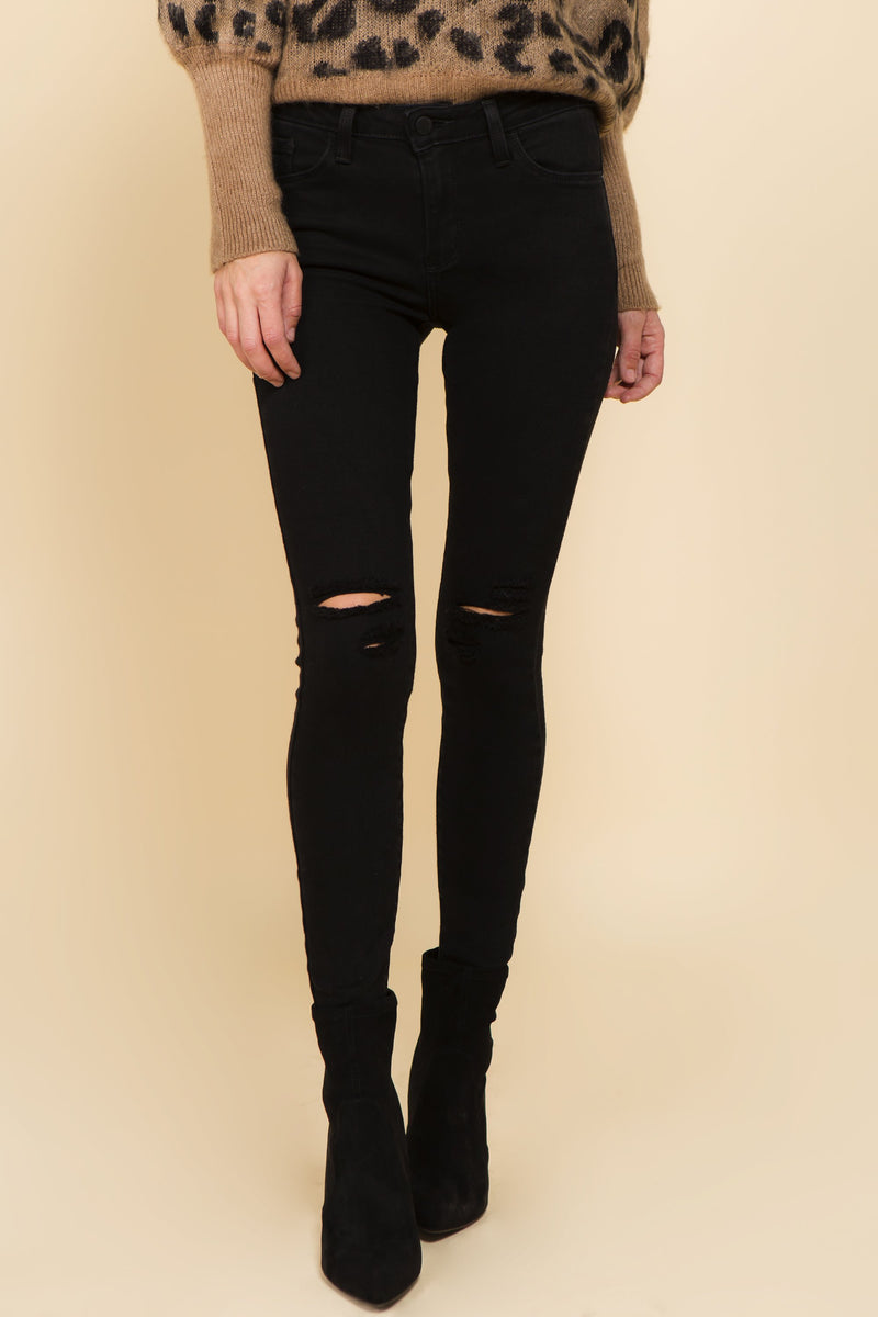 Black distressed denim with a high waist and raw hemline