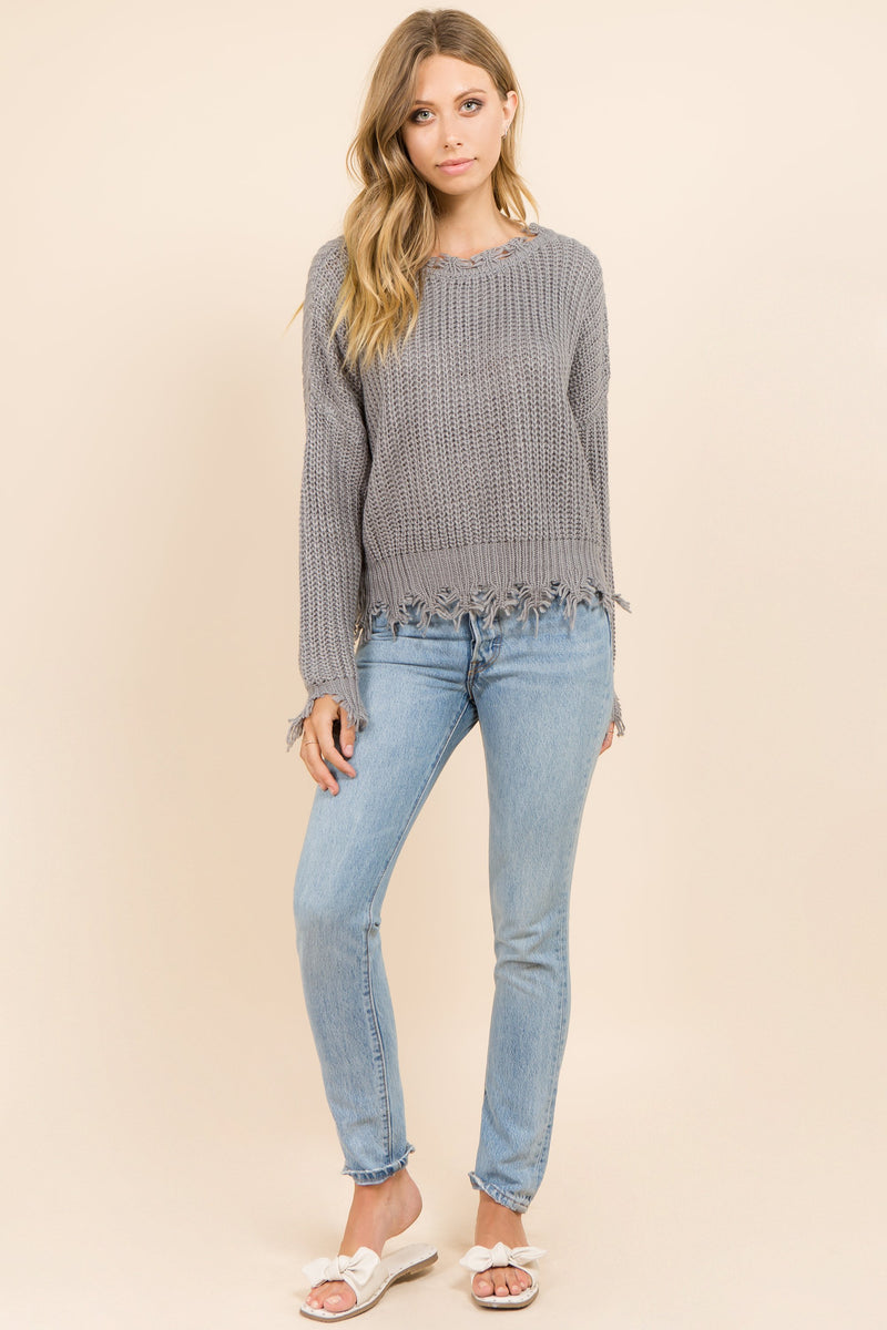Plunging V neck back grey sweater that is distressed and oversized