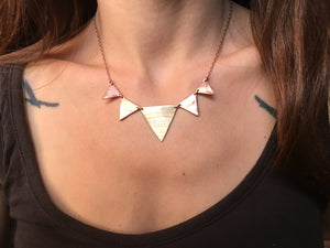 copper and brass triangle celebration bunting necklace