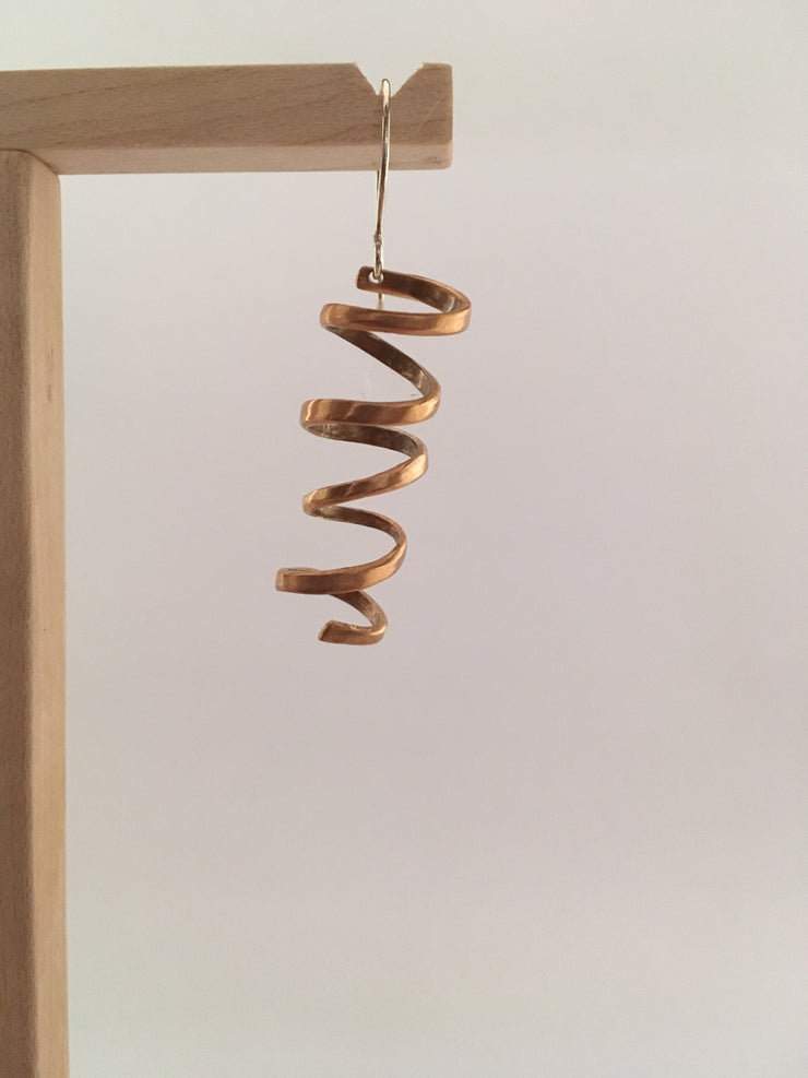 spiral earrings made from brass drum cymbal simple wealth art