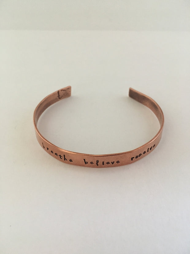 breathe believe receive mantra hand stamped recycled copper cuff