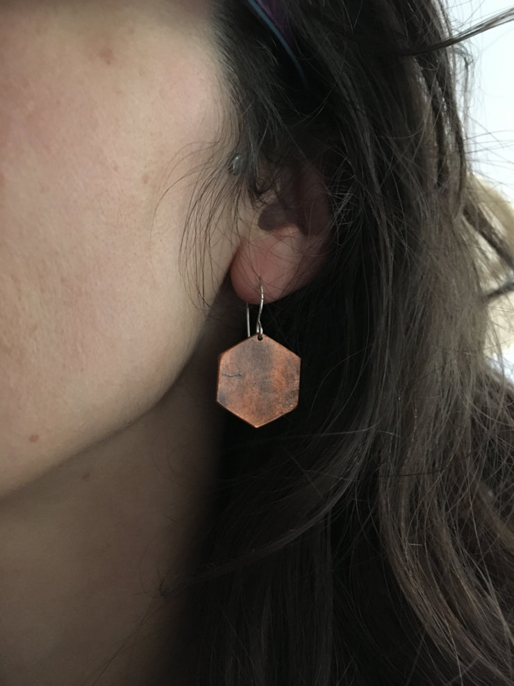 copper hexagon recycled pipe earrings worn by human upcycle simple wealth art
