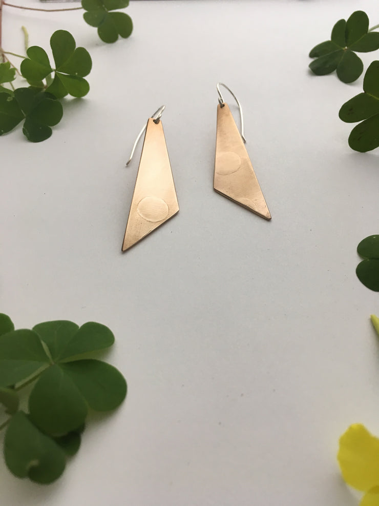 recycled drum cymbal dagger earrings simple wealth art