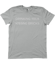 Drinking Milk and Kissing Bricks. (white text)