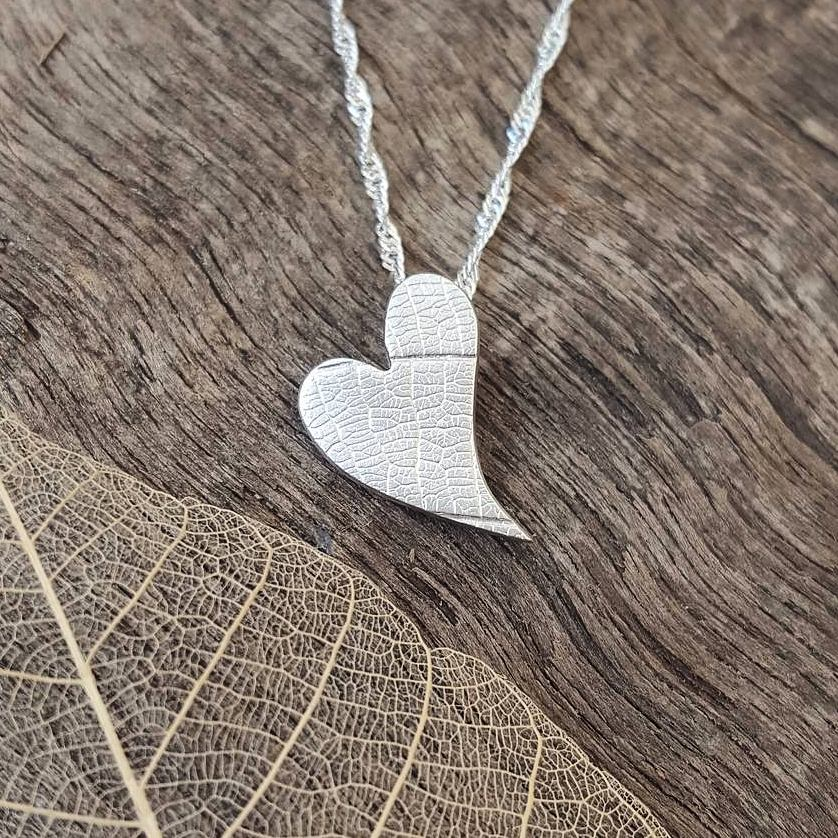 Fine silver elongated heart pendant with a leaf vein texture - Anna Ancell Jewellery