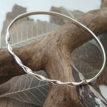 Sterling silver bangle with a tight twist - Anna Ancell Jewellery