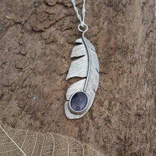 Sterling silver feather pendant with a 10mm x 8mm blue goldstone gemstone - Anna Ancell Jewellery