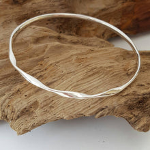Sterling silver bangle with a loose twist - Anna Ancell Jewellery