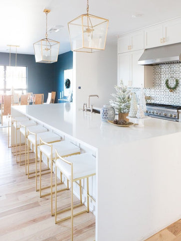White kitchen with brass hardware and fixtures designed by CC and Mike