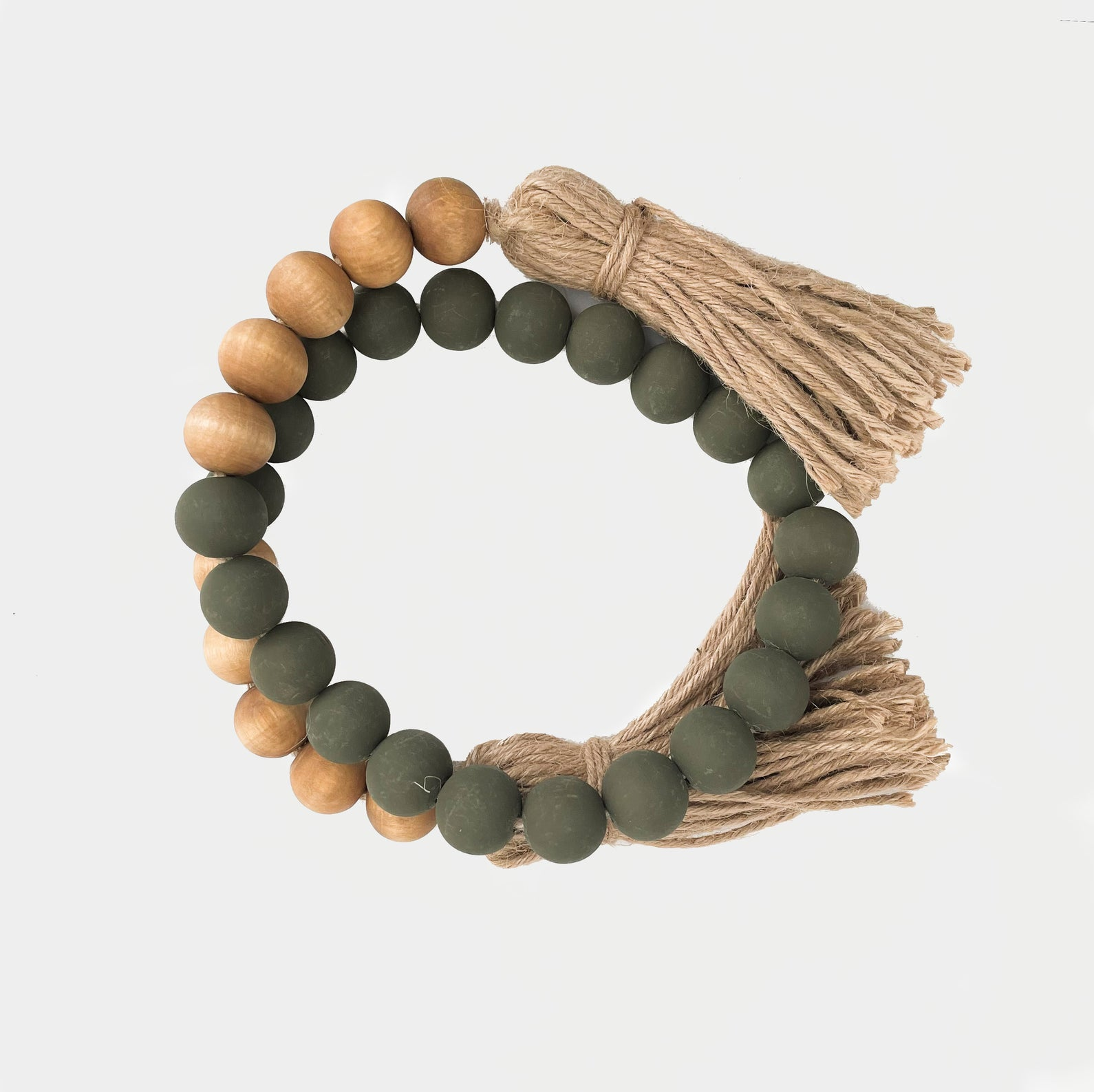 GREEN AND WALNUT WOODEN BEADS WITH JUTE TASSELS