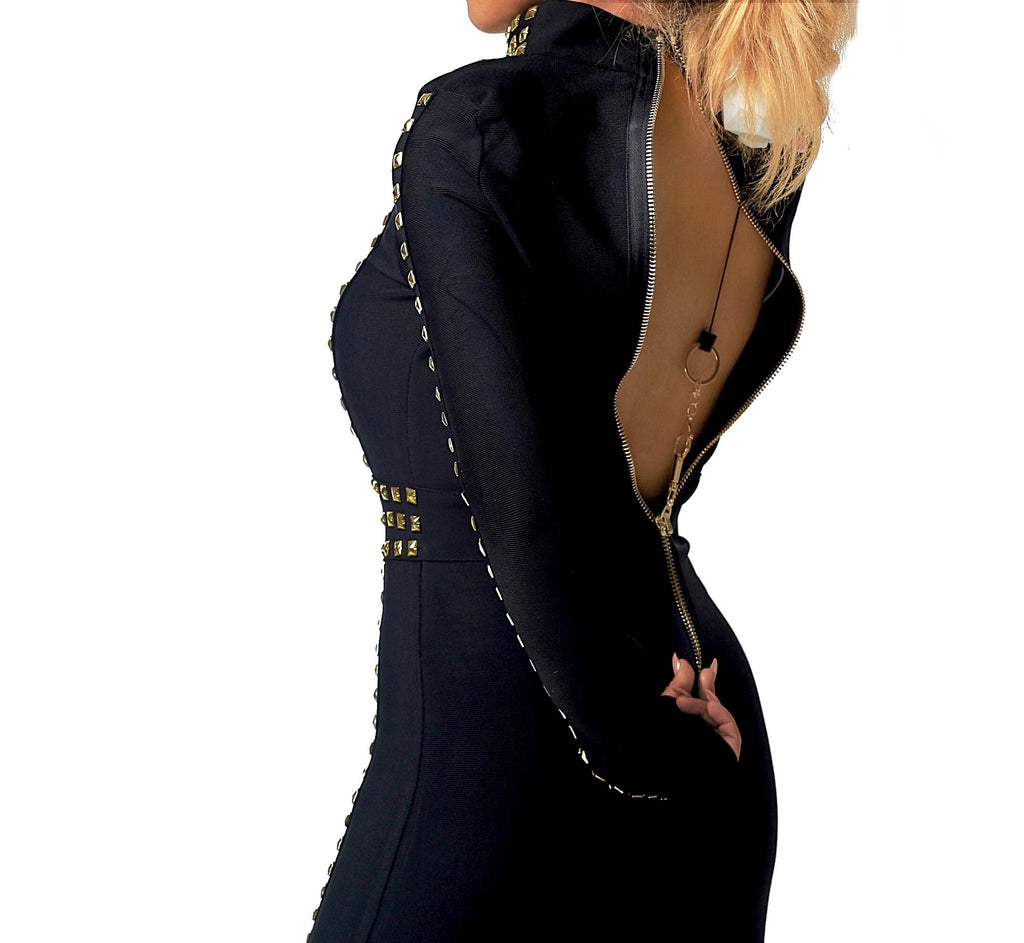 Image of model using Zipa to zip her dress. Zipa is the latest purse accessory/ zipper pulling device that can zip or unzip a dress in 10 seconds or less. Can be purchased at Zipanything.com