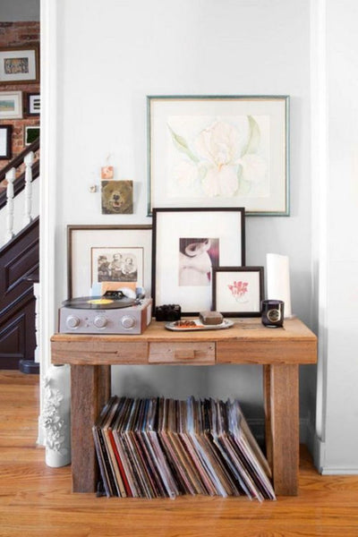 record vinyl collection side table gallery wall bright living room decor ideas