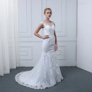 Lace cap sleeve wedding gown