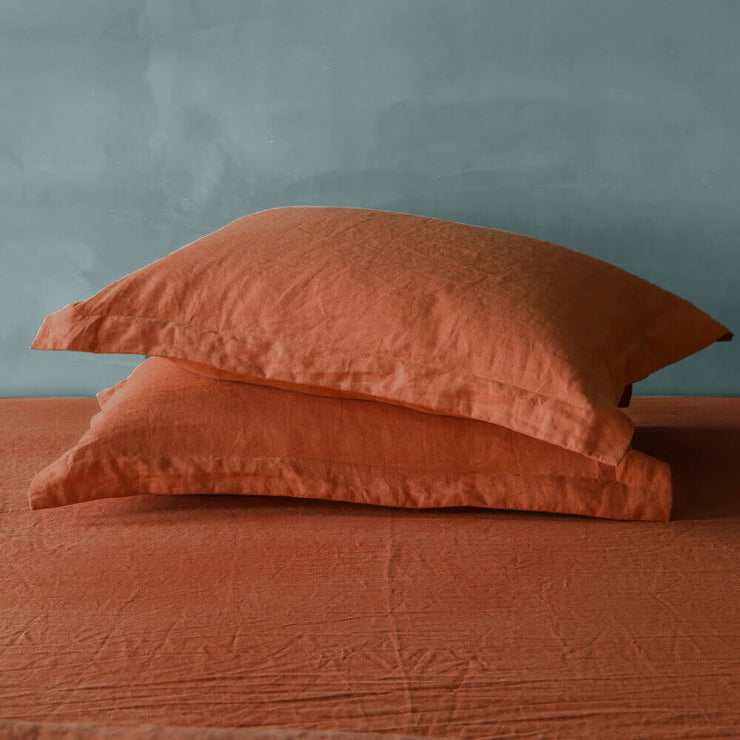 A Pair of Linen Flange Pillow Sham in Coral