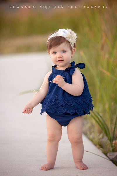 Crochet/embroidered romper in navy blue