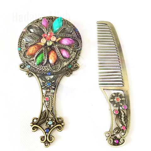 Hand held mirror and comb set