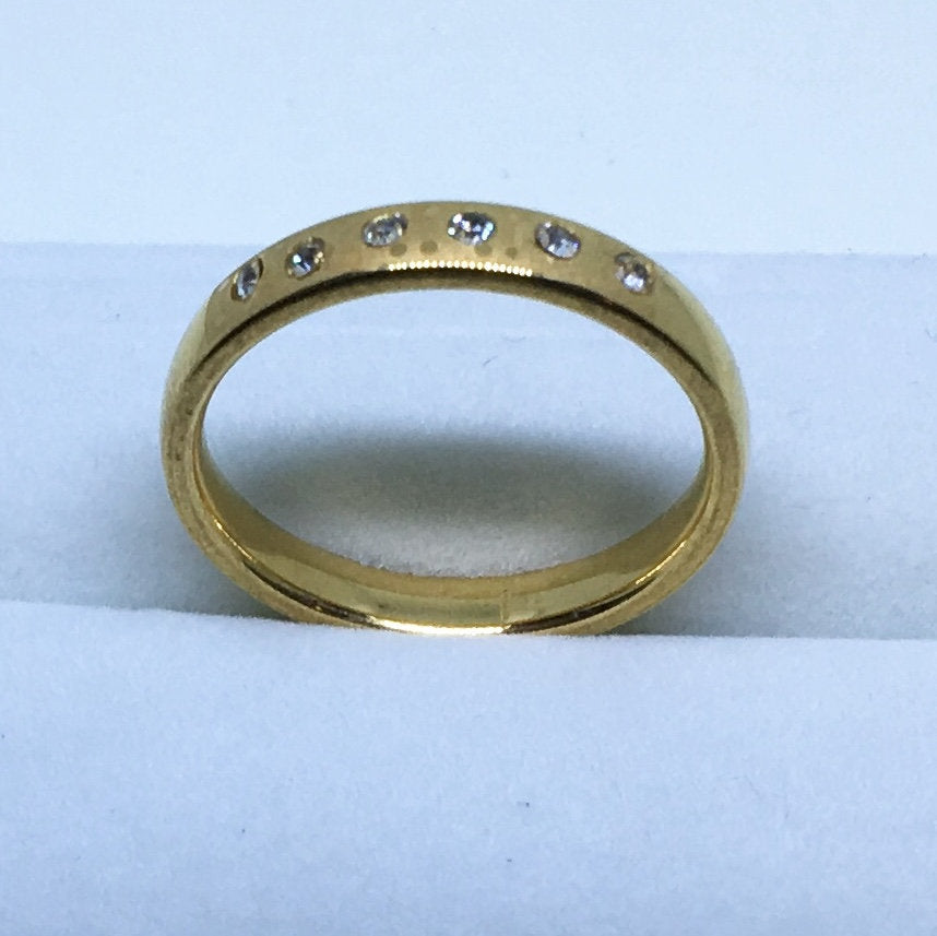 3 . 8 mm Brand New Yellow Gold Plated with White gems in Center on Stainless Steel ring band