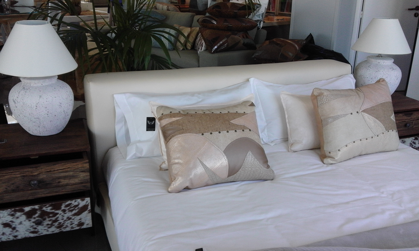 Metallic beige and cream leather pillows