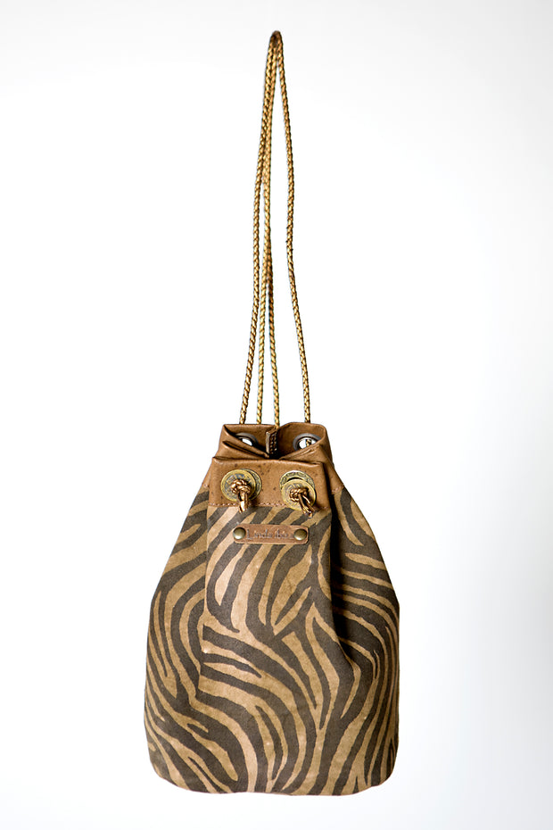 Brown handmade leather bag and backpack with zebra print detail