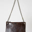 Leather brown hide and hair crossbody handbag with metallic silver circle detail