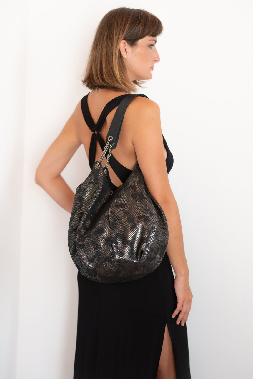 Handmade black leather bucket bag with gold and leather chain shoulder strap Linda Ibiza