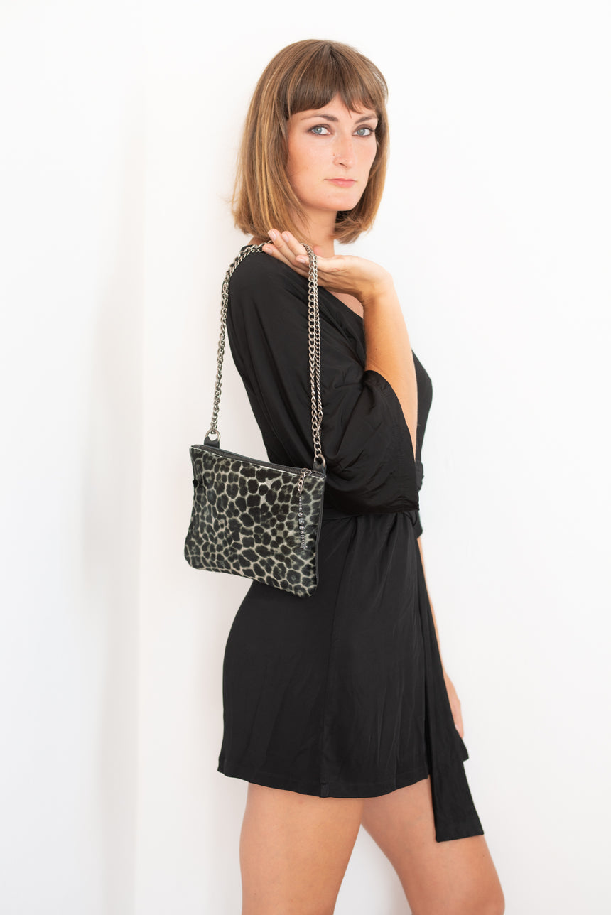 Handmade leather black and white hide and hair crossbody bag with leopard print design Linda Ibiza
