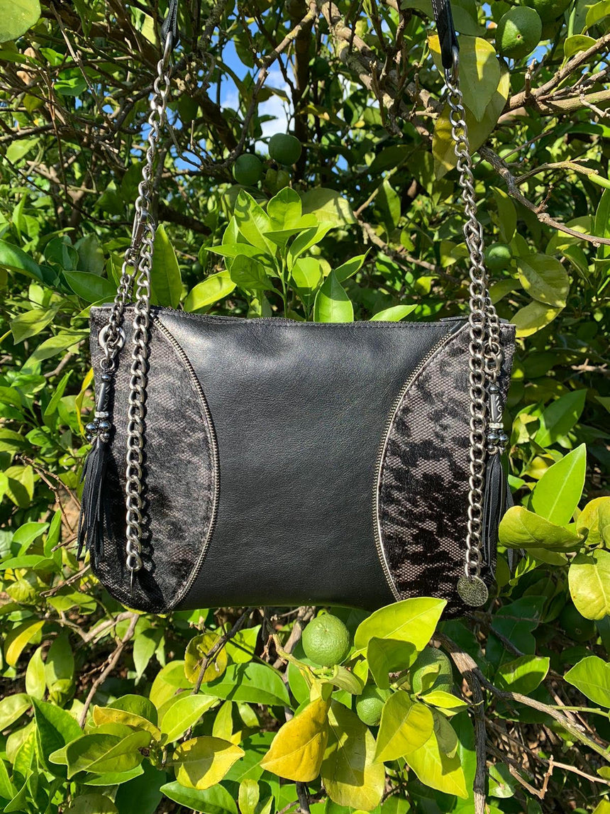 Handmade black leather crossbody bag in smokey leather moon design