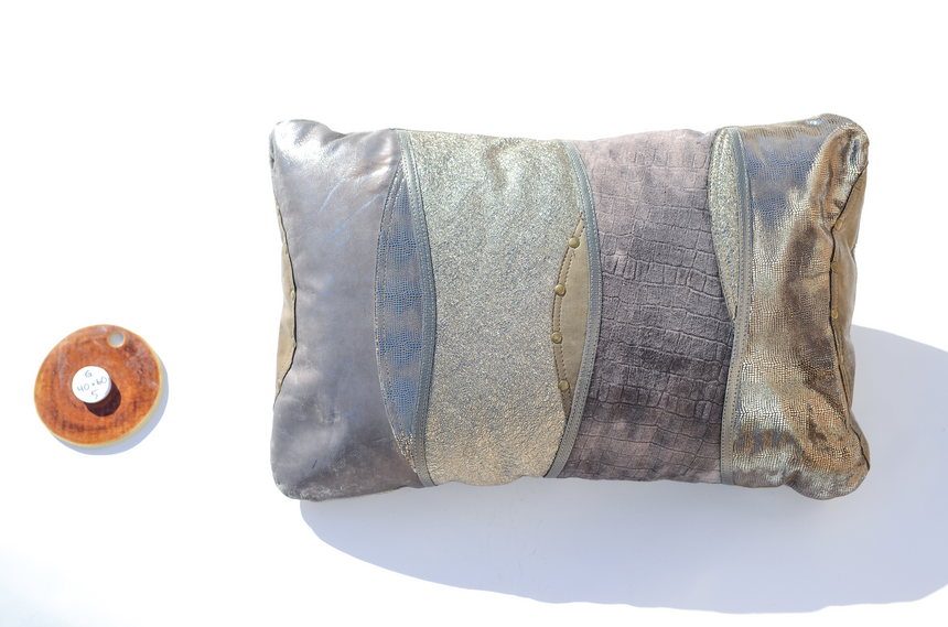 Metallic grey handmade leather pillow in elegant wave design