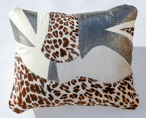 White and silver leather pillow with leopard print accents