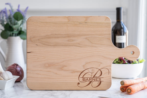 Wooden cutting board with monogram