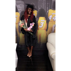 Jessica Ogunnorin the CEO of LEV8 Apparel poses for third graduation at VCU