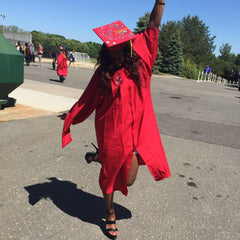 Jessica Ogunnorin the CEO of LEV8 Apparel poses for second graduation at Stony Brook University
