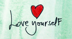Love yourself with a drawing of a red heart