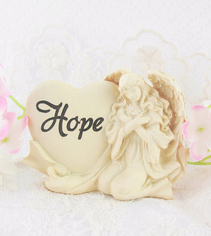 Inspiring Angel of Hope Figurine with Heart available from The Kindness Of Angels