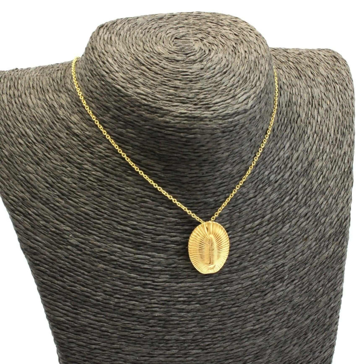 Dickisonia fossil pendant 14K goldplated brass