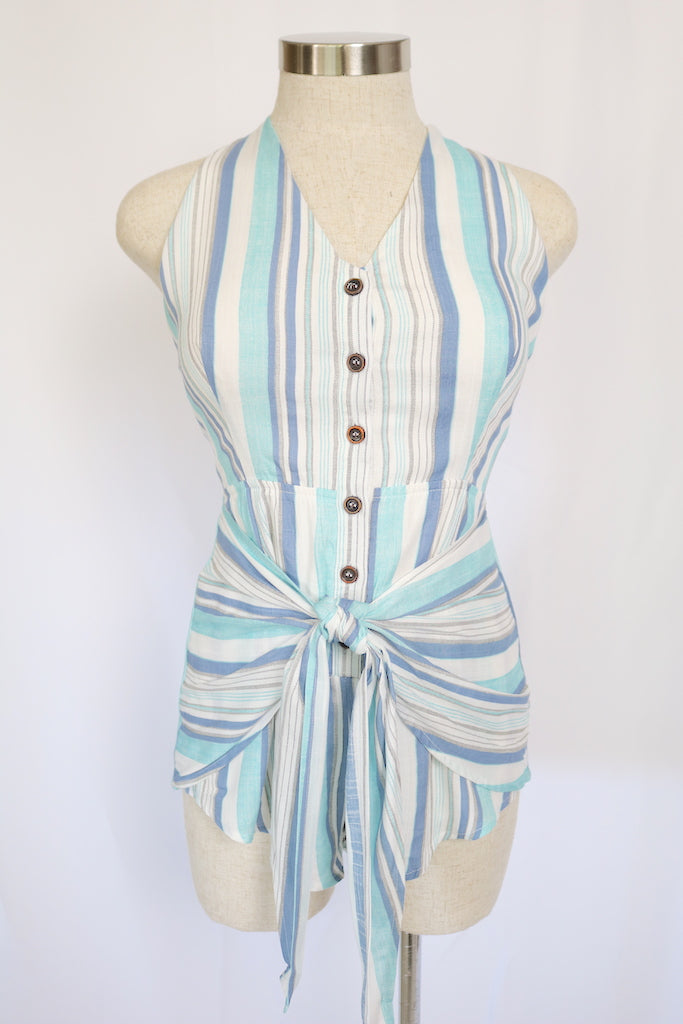 ~This beautifully designed romper was inspired by one thing - summer. Featuring an open back and button-down front. Pair with heels or sandals for a casual look.    ~Fabric: Rayon