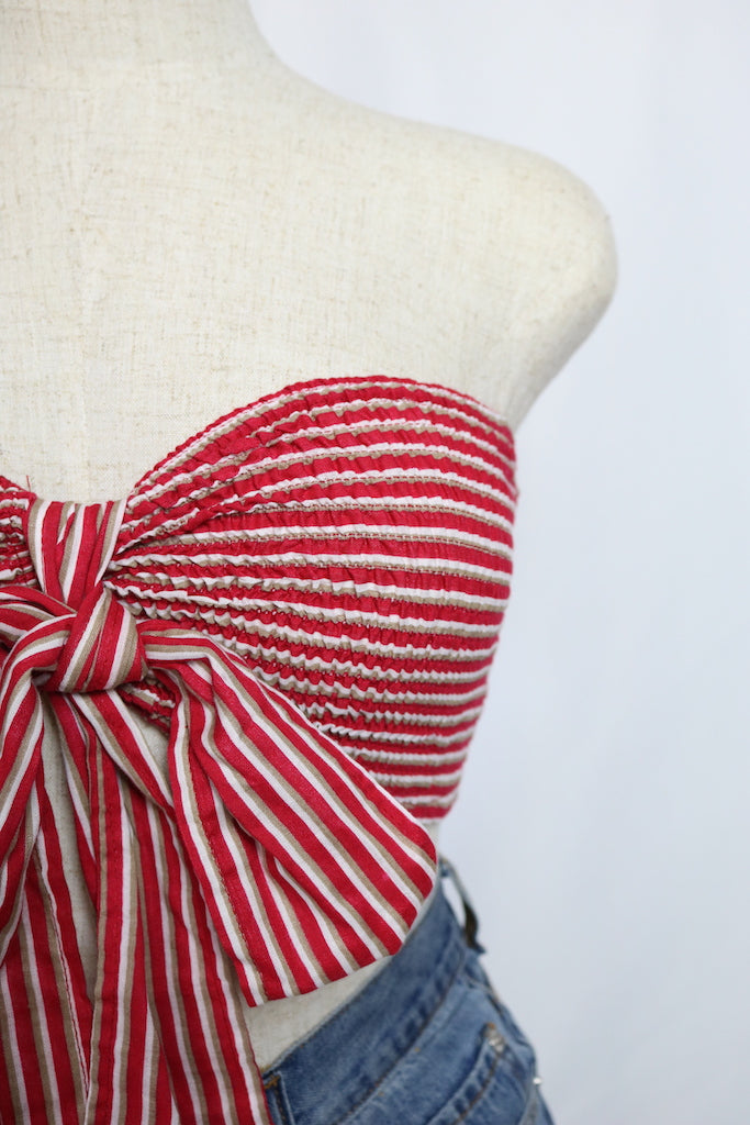 ~Enjoy this summer's 4th of July with our Riley Bow-Top.  ~Removable bow ~smocked tube top  ~Fabric: Rayon / Cotton