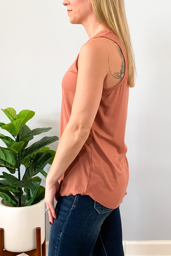 Our Dusty Rose Basic Scoop Neck Tank Top is the perfect relaxed fit tank you'll own this season! This tank features super soft knit fabric, ribbed band neck and sleeves, and raw hemming hem.  Perfect for layering or wearing as is and is long enough to tie or front tuck.